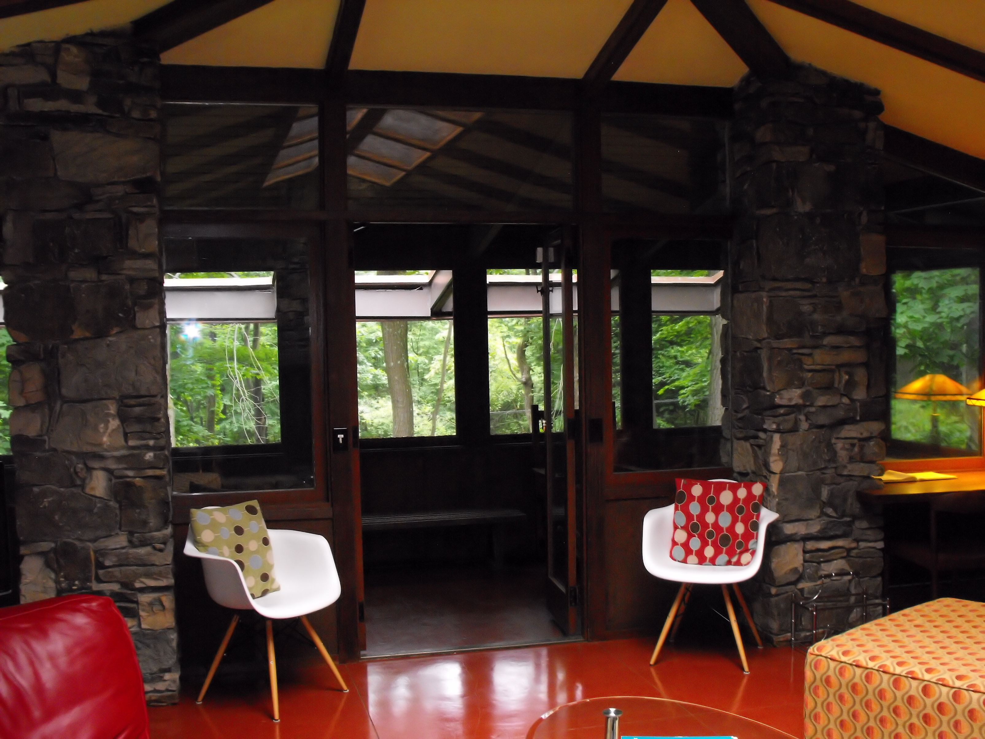 111 balter house living room shot to sun porch.jpg